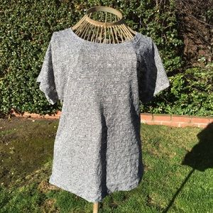 Gray top with weave design. Size 6
